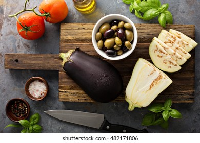 Cooking with eggplant, olives and tomatoes, ingredients for caponata