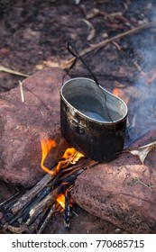 Cooking in field conditions, boiling pot at the campfire