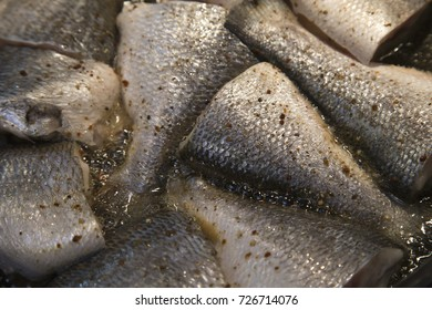Cooking fish, deep fried fishes in hot oil in a frying pan