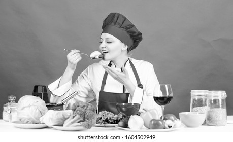 Cooking food and housekeeping. Housewife routine. Professional cooking tips. Woman chef try taste eat food. Delicious recipe concept. Cooking meal. Cooking healthy food. Girl at kitchen table.