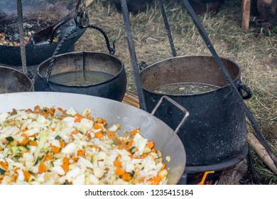 Cooking food in the outdoor cauldrons