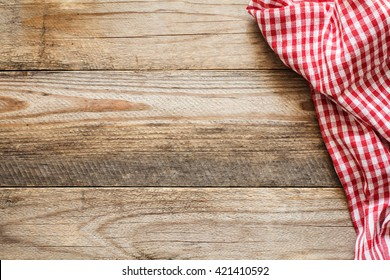 Cooking food / pizza wooden table background with red and white textile. Copy space for text