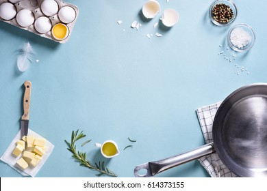 Cooking frame. Ingredients for preparing breakfast with eggs in a frying pan. Top view, text space. Flat lay.