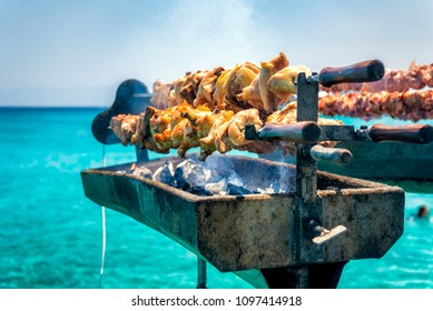 Cooking fresh Cypriot souvla on the sea