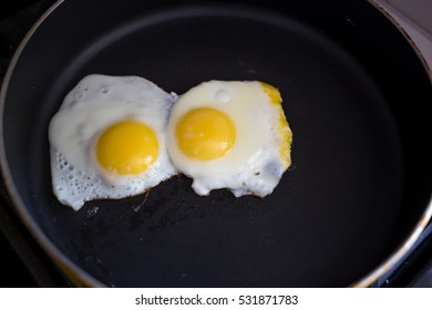 Cooking fried eggs on brekfast.Top view