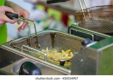 cooking  fries at a fast food restaurant