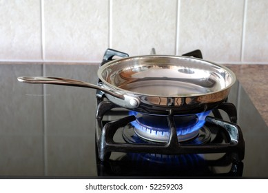 Cooking in a frying pan on a gas stove