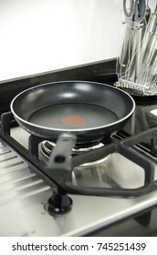 Cooking in a frying pan on a gas stove.