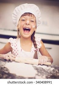 Cooking is fun. Little girl playing with flour
