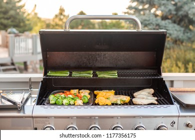 Cooking healthy dinner on outdoor gas grill.