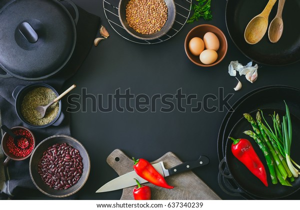 Cooking ingredients dark background with a space for a text, view from above