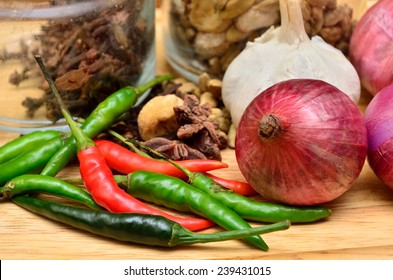 Cooking ingredients. Spice and herbs with onion and garlic on wooden board