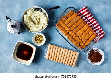 cooking Italian Dessert with cocoa, coffee and mascarpone cheese Tiramisu and all the necessary food ingredients  and utensils. step by step