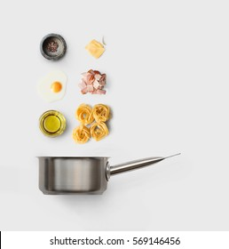 Cooking italian food collage. Ingredients for carbonara pasta, spaghetti, oil, ham, egg and parmesan isolated on white background with saucepan.
