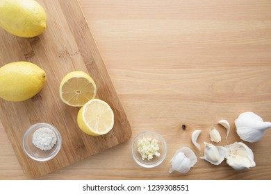 Cooking with lemon and garlic, flat lay with copy space.