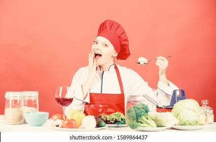 Cooking meal. Delicious recipe concept. Girl at kitchen table. Cooking food and housekeeping. Housewife routine. Cooking healthy food. Professional cooking tips. Woman chef try taste eat food.