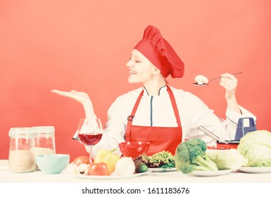 Cooking meal. Woman chef try taste eat food. Delicious recipe concept. Girl at kitchen table. Cooking food and housekeeping. Housewife routine. Cooking healthy food. Professional cooking tips.
