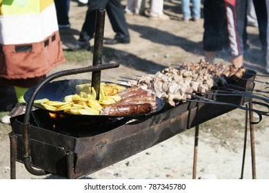 cooking, meat, sausages and potatoes on a holiday