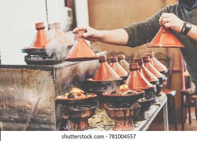 Cooking of meat in traditional Moroccan ceramic tajine dish, Marrakesh, Morocco