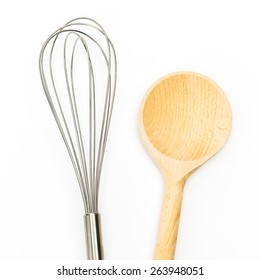 cooking metal whisk with spoon on white background
