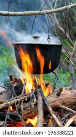 Cooking in the nature. Cauldron on fire in forest