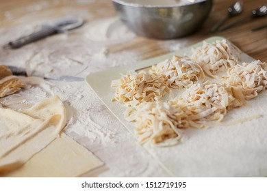 cooking  with a noodle slicer dough for pasta uncooked noodles