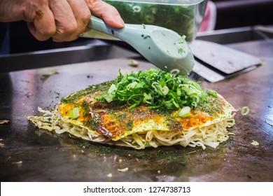 Cooking Okonomiyaki in Hiroshima, Japan