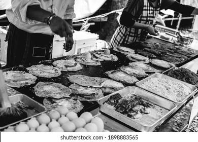 Cooking okonomiyaki pancakes, at Aoi Matsuri celebrations, Kyoto (in black and white) - Shutterstock ID 1898883565