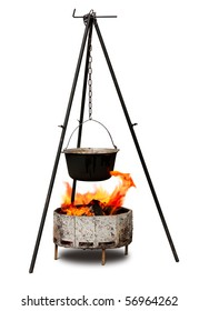 Cooking in old cast-iron on tripod isolated over white