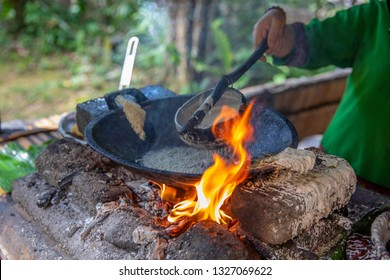 cooking on fire in the tribe. Mari Mari Cultural Village