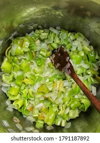 Cooking onion with green peppers
