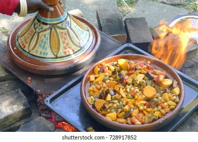Cooking a oriental meal in the Tajin in the garden
