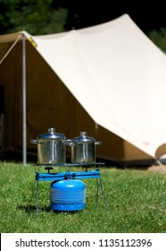 Cooking outdoors with gas stove on camping site