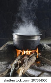 Cooking over open fire at campsite