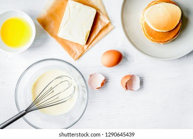 cooking pancake on white background top view ingredients for making