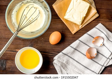 cooking pancake on wooden background top view ingredients for making