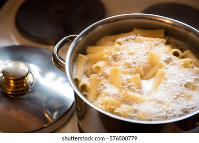Cooking pasta in pot on stove top