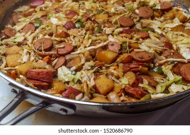 Cooking Polish kielbasa potatoes onions and peppers hash with cole slaw