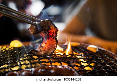 cooking pork slice with fire in Asian  unhealthy food make fat and cancer
