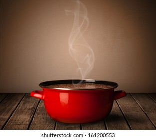 cooking pot on old wooden table