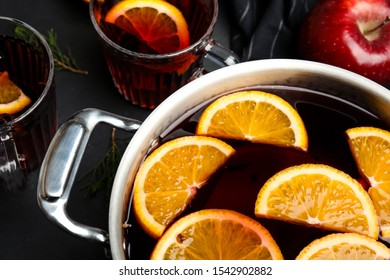 Cooking pot of tasty mulled wine with spices on table, closeup