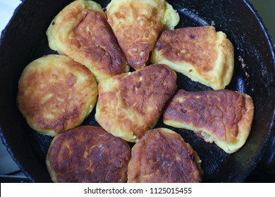 Cooking process of delicious fried syrniki or cheesecakes close-up in the pan.