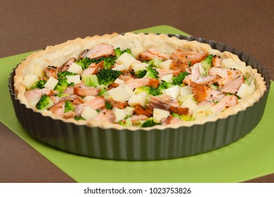Cooking Process Of Salmon Quiche With Broccoli. Traditional British Food