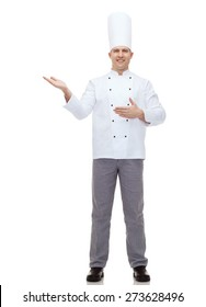 cooking, profession and people concept - happy male chef cook inviting