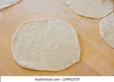 cooking raw round dough close up shot