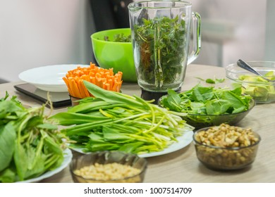 Cooking raw vegan spreads and sauces for a party with a variety of gluten free finger food and healthy snacks rich in vitamins