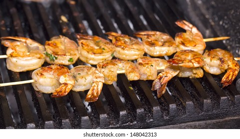 cooking shrimp on the grill in the restaurant