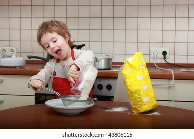 Cooking and singing boy in the kitchen