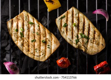 Cooking Sliced Eggplant on a Barbecue Grill with Charcoal