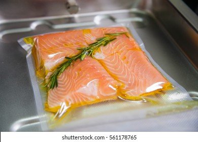 Cooking sous vide salmon with rosemary and olive oil.